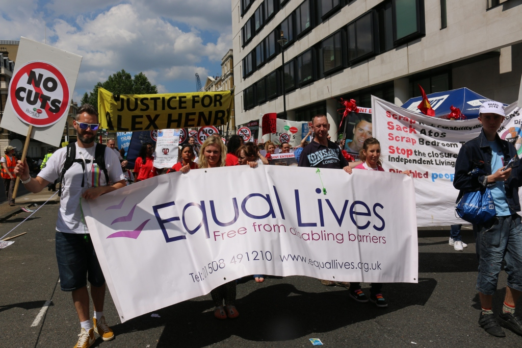 """Mathew and Dan from Equal Lives, Norwich feature in """"Stop Cuts Against Vulnerable Disabled People"""" and """"Stop Lying About the NHS""""."""